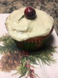 Festive decorated Christmas cupcake with cranberry on top Stock Photography