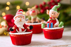 Festive decorated Christmas cupcakes Stock Photos