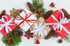 Festive decorated Christmas gift boxes and decor are in line on a white background. Top view. Stock Image