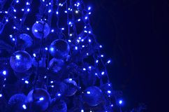 Festive decorated Christmas tree with blue led lights stock images