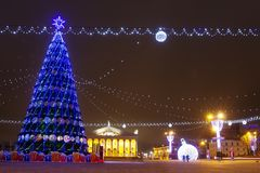 Festive decorated Christmas tree on square in winter Minsk. Celebration New Year and Xmas in night Minsk.  royalty free stock photos