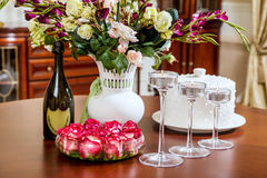 Festive decorated table in the interior before Christmas Stock Photo