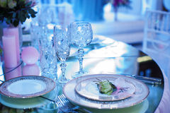 Festive decorated table in the restaurant for Christmas in blue and white tone Stock Photo