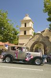 Festive decorated vintage Rolls Royce makes its way down main street during a Fourth of July parade in Ojai, CA Royalty Free Stock Photography