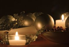 Festive decoration. Candle lit holiday decorations royalty free stock images