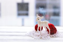 Festive decoration, beads and christmas balls and figurine Stock Photos