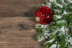 Festive decoration red christmas ball with pine branches Royalty Free Stock Photography