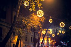 Festive decoration of Tirana city center. The center of Tirana decorated with lights for new year holidays defocused for bokeh Stock Photo