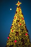 Festive decoration of Tirana city center. The center of Tirana decorated with lights for new year holidays defocused for bokeh. christmas tree Royalty Free Stock Photo