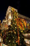 Festive decoration of the traditional holiday Shrovetide near the Kremlin walls on Manezhnaya Square in Moscow. Festive lights of the city of Moscow on the royalty free stock photos