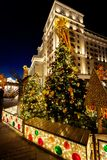 Festive decoration of the traditional holiday Shrovetide near the Kremlin walls on Manezhnaya Square in Moscow. Festive lights of the city of Moscow on the royalty free stock photo