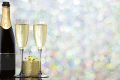 Festive decoration with two glasses of champagne. And a blurred background Royalty Free Stock Images