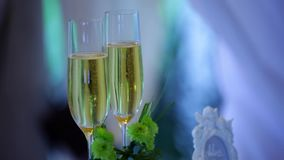 Festive decoration with two glasses of champagne and a blurred background stock footage
