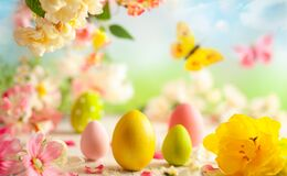 Free Festive Decoration With Easter Eggs And Beautiful Spring Flowers On A Blurred Light Background. Easter Concept With Copy Space Stock Photos - 211853263