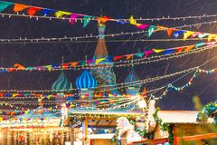 Festive decorations Christmas fair in Moscow and blizzard evenin Royalty Free Stock Image