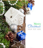 Festive decorations with small house, baubles and gift boxes Stock Images
