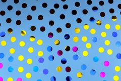 Round confetti on blue background. stock photos