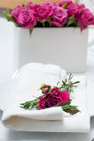 Festive dining table setting with pink roses. White tablecloths and napkins, candles, holiday dinner Royalty Free Stock Photography