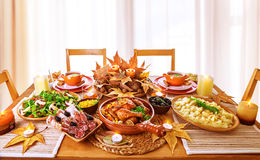 Festive dinner. At home, Thanksgiving day celebration, backed chicken, cold cuts, potato garnish, fresh green salad, traditional food for autumnal holiday Royalty Free Stock Images