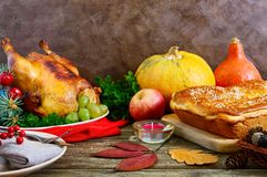 Festive dinner for Thanksgiving. Traditional Thanksgiving dishes. Turkey, pumpkin pie on the holiday table royalty free stock photography