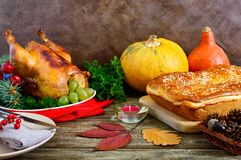 Festive dinner for Thanksgiving. Traditional Thanksgiving dishes. Turkey, pumpkin pie on the holiday table stock photo