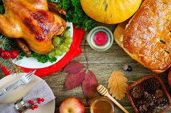Festive dinner for Thanksgiving. Traditional Thanksgiving dishes: turkey, pumpkin pie. On the holiday table. The top view stock image
