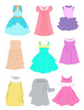 Festive dresses for little girls. On white background Royalty Free Stock Photo