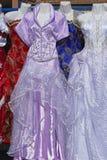 Festive dresses. Second hand festive dresses at flea market Stock Photography