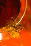 Festive Drink 2. Abstract closeup of a drink with garland linked over the edge of the glass Royalty Free Stock Photos