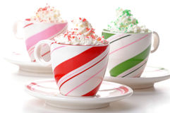 Festive Drinks. Three colorful mugs of festive drinks with whipped cream Royalty Free Stock Photography