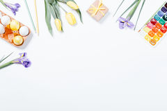 Festive Easter arrangement of flowers, painted eggs and watercol Stock Image