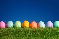 Festive Easter background colorful eggs. Festive Easter background with colorful eggs on grass Stock Photos
