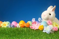 Festive Easter background with rabbit, flowers, and colorful egg. S Royalty Free Stock Photography