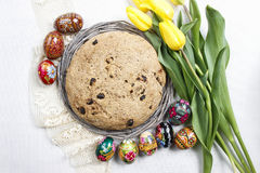 Festive easter bread, beautiful yellow tulips and easter eggs Stock Image