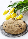 Festive easter bread and bouquet of beautiful yellow tulips Royalty Free Stock Photo
