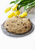 Festive easter bread and bouquet of beautiful yellow tulips Royalty Free Stock Image