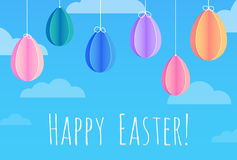 Festive Easter card with hanging paper origami eggs. Greeting in the sky with clouds Royalty Free Stock Photography