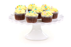 Easter cupcakes. Festive easter chocolate cupcakes on white ruffled cake stand Stock Image