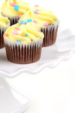 Easter cupcakes. Festive easter chocolate cupcakes on white ruffled cake stand Royalty Free Stock Photography