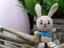 Knitted toy Bunny in the background of Easter egg royalty free stock photo