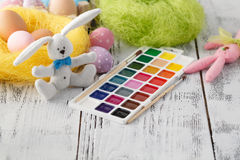 Festive easter decoration on white table with pastel color eggs Stock Photo
