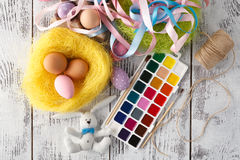 Festive easter decoration on white table with pastel color eggs Stock Images