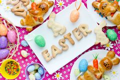 Festive Easter dinner table with homemade sweet treats for kids. Happy Easter background stock photo