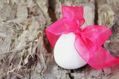 Festive Easter Egg with Purple Bow Royalty Free Stock Images