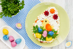 Festive Easter Egg salad with a little funny chicken and colored Royalty Free Stock Image