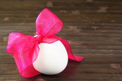 Festive Easter Egg Tied with Purple Ribbon Royalty Free Stock Photo