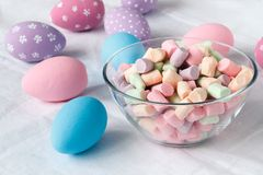 Festive easter eggs on table with ribbons Royalty Free Stock Image
