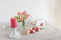 Festive Easter spring table setting with flowers stock photo