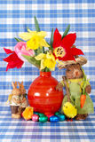 Festive easter sweets, eggs and tulips Stock Image