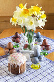 Festive Easter table decorated with flowers, colored eggs and cakes Stock Image